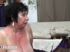 Horny granny fucked by two strong young guys