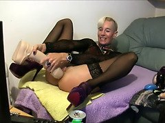 Pierced grannie cougar enjoys giant ebony dildo anal