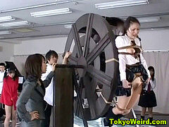 japanese schoolgirls punished on waterwheel
