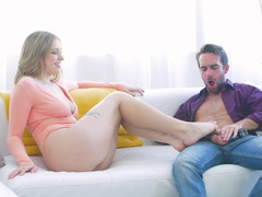 Lovely girl works with her feet, mouth and hands to make guy happy