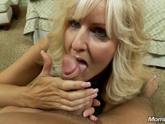 Old blonde hooker slobbers on youner dick then gets doggyfucked in POV