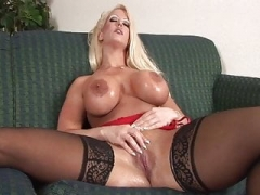 Sweet blond with big titties has a giant sextoy