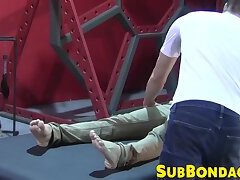 Petite slave restrained for rough BDSM tormenting session