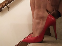 Cumming in red heels