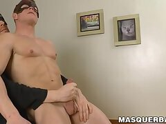 Masked hunk jerks off while caressed by his buddy