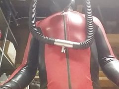 Latex catsuit and heavy rubber helmet