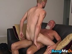 Tattooed twink receives a big mature boner up the rear