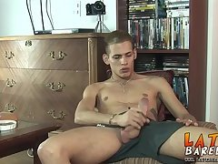 Hot Latino twink Angelo strokes his large meaty cock