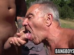 Old gay man lets his mouth be filled with a young cock