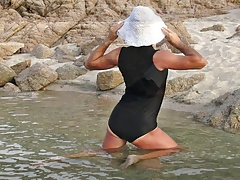Swimsuit sexy crossdresser photo in the beach