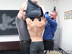 Sexy hunk gets double dicked by horny daddies in classroom
