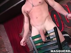 Muscular hunky stripper stroking his massive cock solo