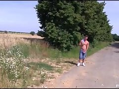 Bisex in a field by the road