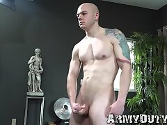 Muscular bald army gay Alan B wanks off his thick cock