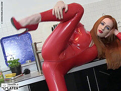lithe female red latex catsuit sandy-haired