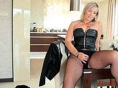 blondie MILF in Fishnet stocking and high high-heeled shoes