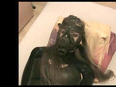 super-cute woman tied and gasmasked