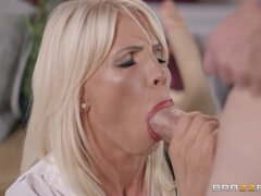 A sex ed lesson from a stunning blonde cougar in black nylons