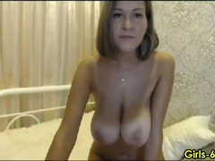 very busty MILF loves stripping and getting naked on webcam
