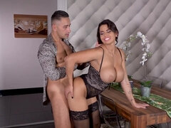 Stud bangs a busty brunette in lingerie from behind