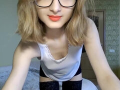 Cute teen Lina in glasses on webcam