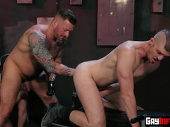 Buff hunk gets his cock sucked and fistfucks two studs