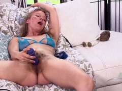 Natasha gets her hairy pussy wet with a vibrator