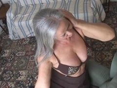Charming bigtitted granny in stockings stripping