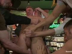 Handsome gay bitch gets fucked by his buddies in a shop