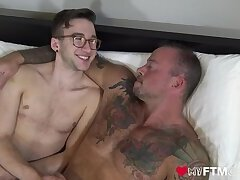 Hairy transgender FTM jock talking and holding hands with inked hunk