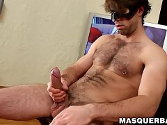 Masked hairy hunk is stroking his big fat cock solo