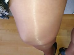 Crossdresser in layered shiny pantyhose and stockings