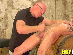 Twinkie trussed up on a barrel and jerked off by older weirdo